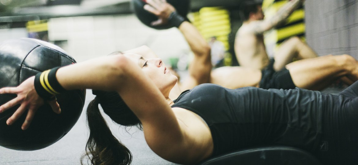 Young woman doing crossfit situps